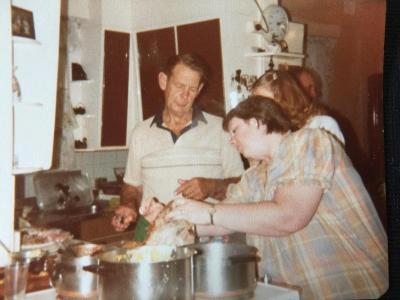 Christmas Day. Cooking Gertrude Ridge's Pudding Recipe. Left to right. Rex Mahony, Teri Browning, Cheryl Hansen.