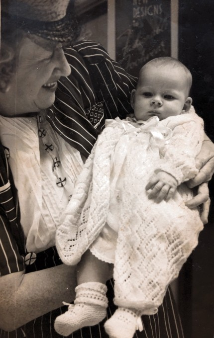 My grandmother holding me as a newborn